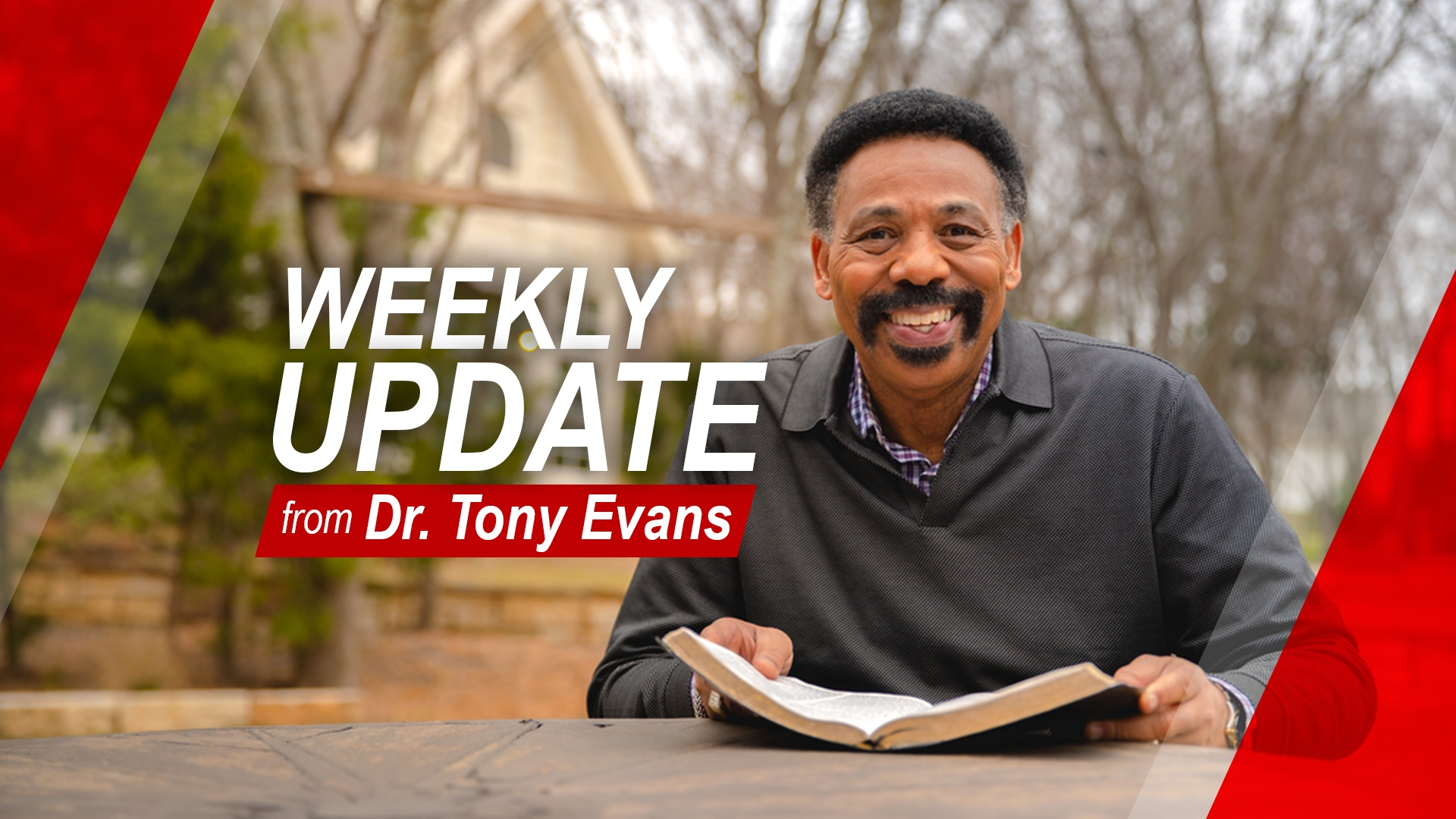 Dr. Tony Evans sitting holding an open Bible - Weekly Update