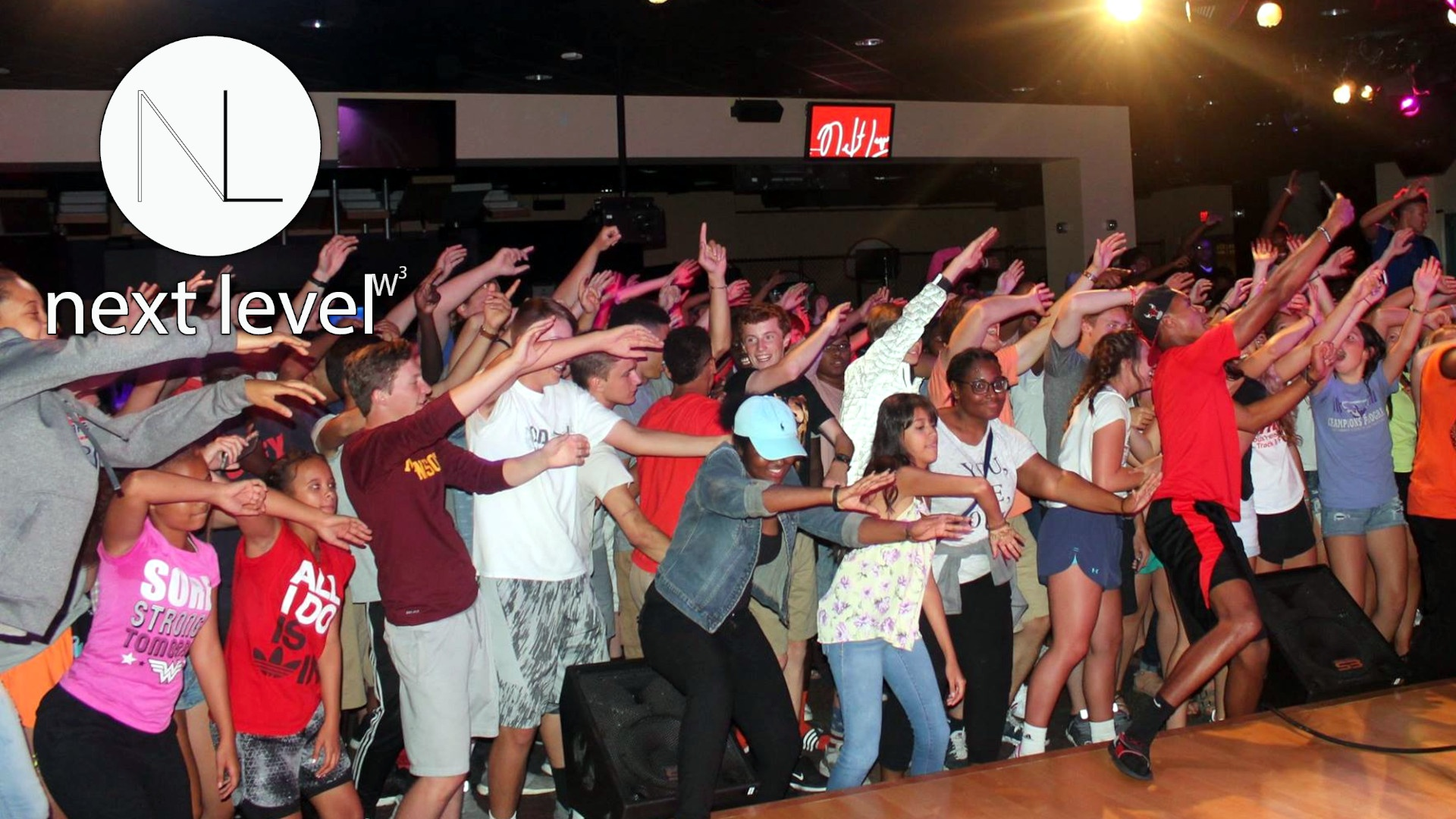 OCBF Next Level Youth worshipping in the education center - logo included
